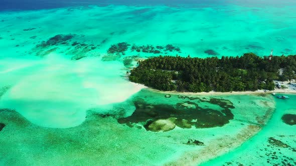 Thumbnail for Wide aerial island view of a white sandy paradise beach and blue sea background in best quality 4K