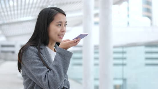 Thumbnail for Business woman use of mobile phone at outdoor