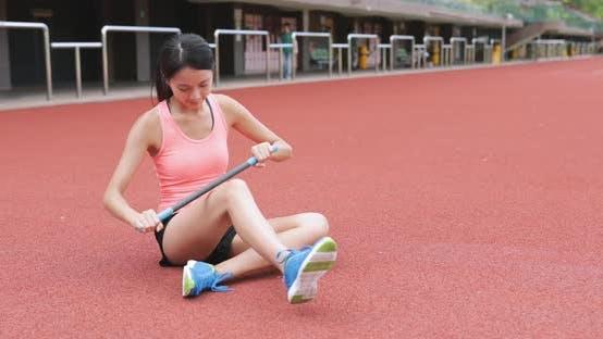 Thumbnail for Sport woman using roller stick in sport stadium