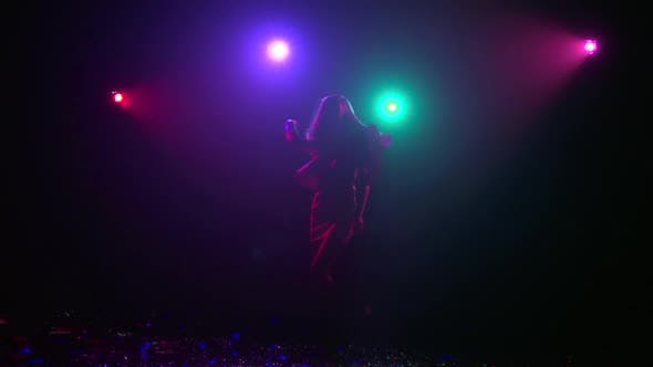 Thumbnail for Silhouette of Girl Dancing with Disco Style Lights, Slow Motion
