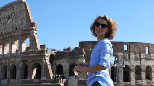 Thumbnail for Young Female Traveler Taking Photo Of Famous Landmark Using Cell Phone. Trip To Europe.
