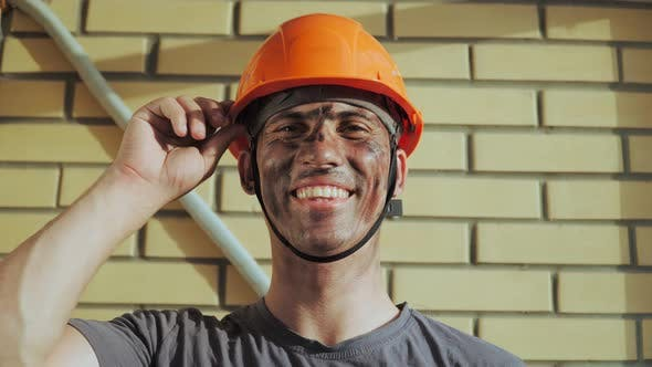 Thumbnail for Dirty Building Worker on Background Brick Wall