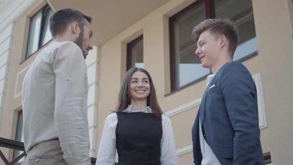 Thumbnail for Young Woman and Two Men in Formal Wear High Five Together on the Terrace. Business Relationship
