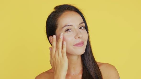 Thumbnail for Cheerful Brunette Applying Cream
