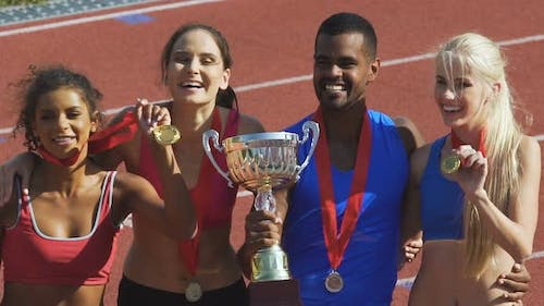 Happy Athletes Proudly Demonstrating Their Cups and Medals, Honored Awards