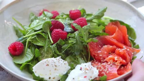 Summer salad with salted salmon, ricotta and raspberries.