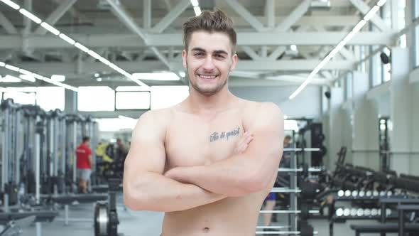 Thumbnail for Attractive Shirtless Blond Male Bodybuilder in Shorts Indoors in Dark Gym, Showing Muscular Torso