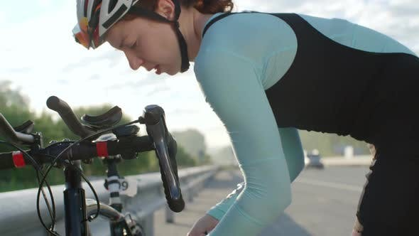 Thumbnail for Female Racer Inflating Bicycle Tires