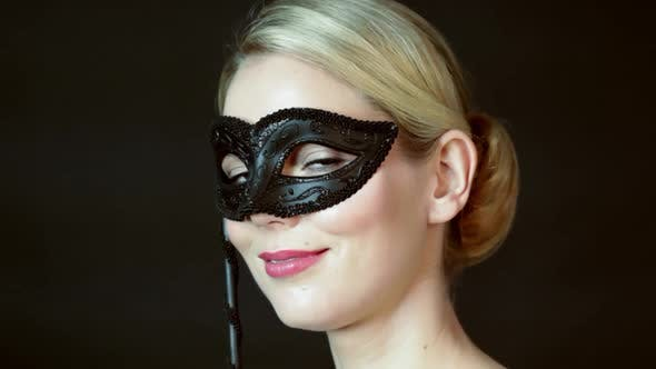 Thumbnail for Young woman wearing costume mask