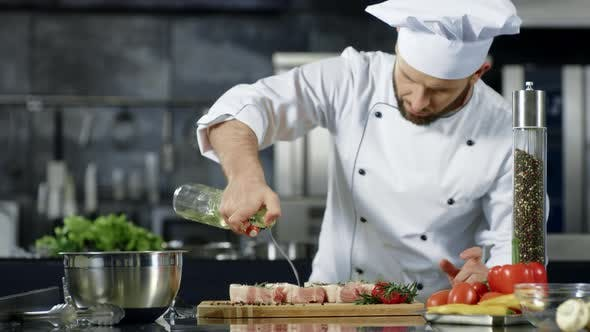 Thumbnail for Chef Cooking Meat at Professional Kitchen. Portrait of Chef Cooking Raw Steak.