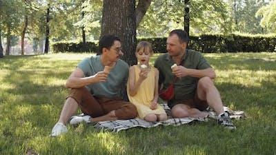 LGBTQ Family Enjoying Time In Park