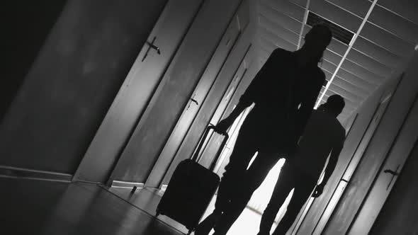 Thumbnail for Silhouette of Woman Walking along Hotel Hallway