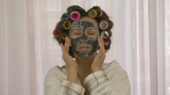 Woman doing cosmetology procedures at home. Skincare. Beauty and cosmetology