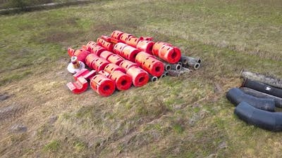 Red Plastic Floats on the Ground on the Field
