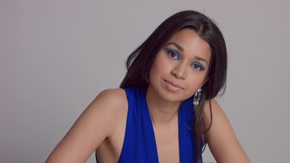Thumbnail for Mixed Race Young Woman Withbright Blue Makeup in Studio Shoot in Electric Blue Dress