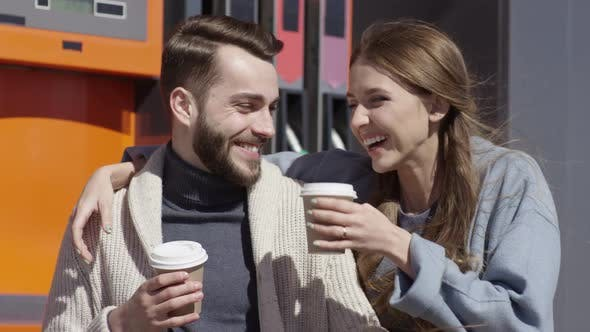 Thumbnail for Loving Woman Bringing Coffee to Boyfriend at Gas Station