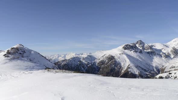 Thumbnail for Panorama on snow capped mountain peaks and ridges of the majestic Alps in winter season