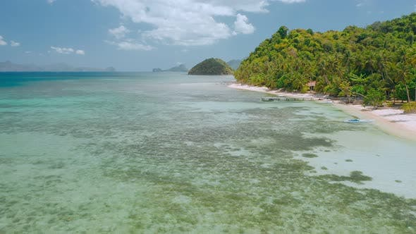Thumbnail for Aerial Drone Flying Around Lagoon with Shallow Clear Water Near To Paradise Tropical Beach