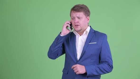 Thumbnail for Happy Overweight Bearded Businessman Talking on the Phone