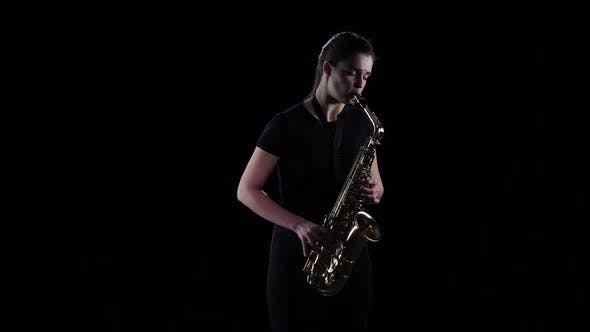 Thumbnail for Woman Plays on the Saxophone Blues Melody in Slow Motion