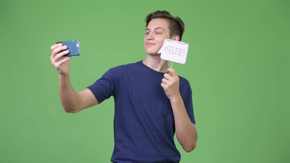 Thumbnail for Young Handsome Teenage Boy Taking Selfie