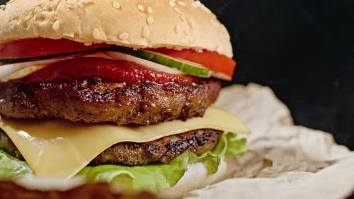 Yummy Hamburger, Fast Food Concept. Fresh Homemade Grilled Burger with Meat Patty, Tomatoes
