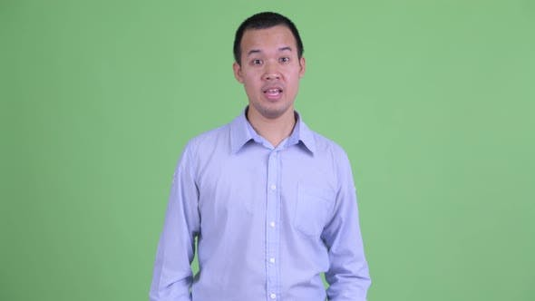 Cover Image for Studio Shot of Happy Asian Businessman Explaining Something