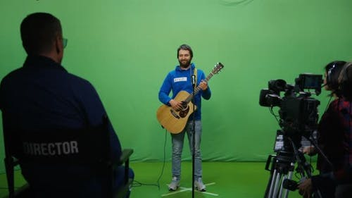 Guitarist Performing at an Audition