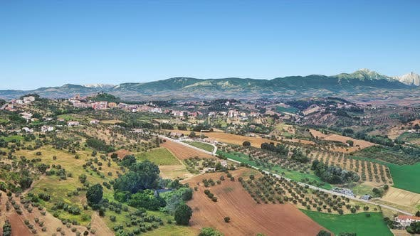 Thumbnail for Village Farms And Mountains Aerial View