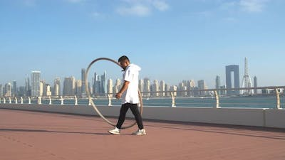 Beautiful View on Dubai Marina and Ain Dubai in the Background of a Gymnast