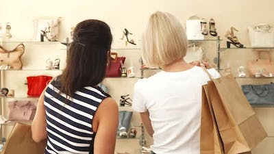 Women Choosing Shoes in Shoe Shop