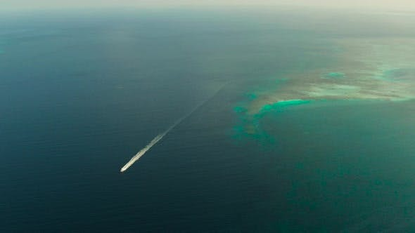Thumbnail for Seascape, Coral Reef and Blue Sea with Motorboat. Balabac, Palawan, Philippines.
