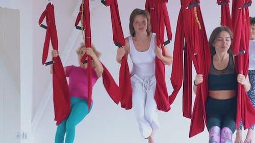 Ladies Restore Energy Swinging in Hammocks After Yoga Class
