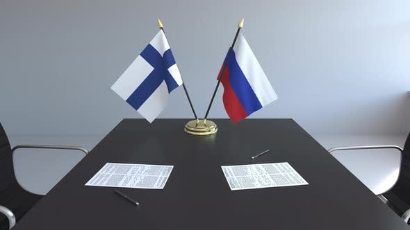 Flags of Finland and Russia on the Table