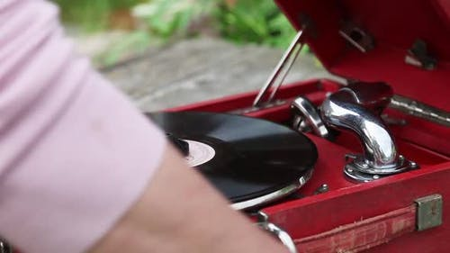 They Start Up an Old Gramophone