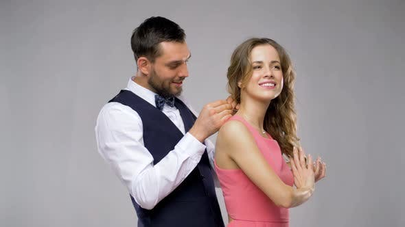 Happy Man Giving Diamond Necklace To Woman 8