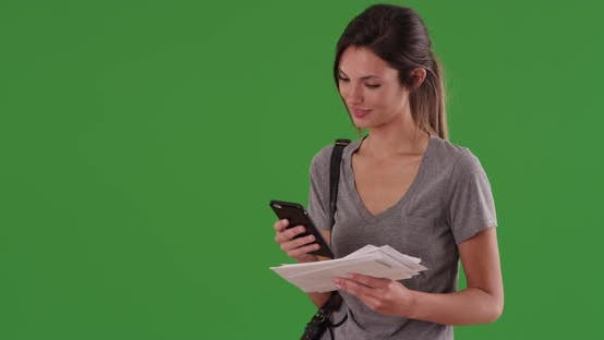Thumbnail for Woman with mail checking smartphone app for nearest post office on greenscreen