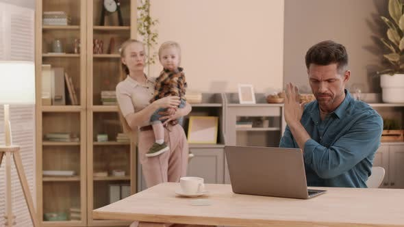 Working Man Distracted by Family