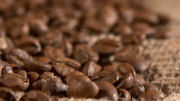 Thumbnail for Coffee Beans on Burlap Sacking Background and Dynamic Change of Focus, Rotation, Close Up