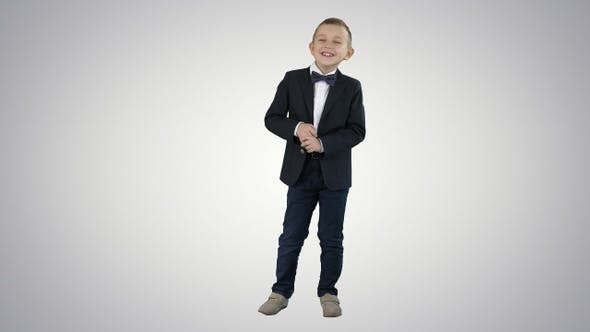 Thumbnail for Little boy in formal outfit talking and smiling on gradient