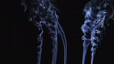 Weaving Curls From Streams of Smoke Streaming Upward