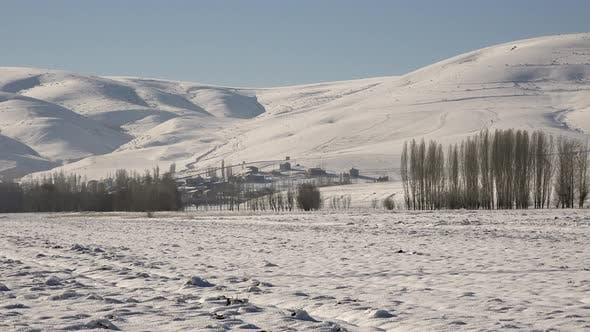 Thumbnail for Village Houses on Edge of Snowy Large Plain and Hill Slope in Winter Siberia Russia