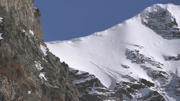 Cover Image for Snow Eaves and Rocky Cliff at Mountain Summit