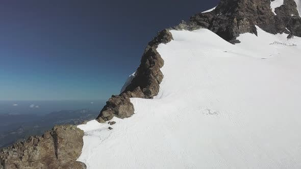 Thumbnail for Majestic Drone View of Snow Capped Peaks in Switzerland