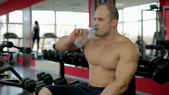 Thumbnail for Muscular man drinking fresh water after active workout in gym, healthy lifestyle