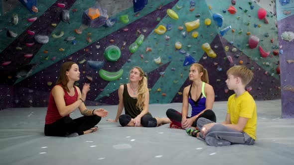 Thumbnail for Climbers Getting Instructions before Practice at Climbing Gym