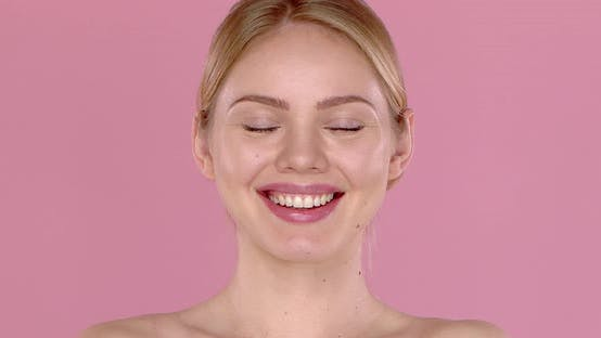 Thumbnail for Slow Motion Video Shot of Smiling Beautiful Girl, Isolated on Pink Background