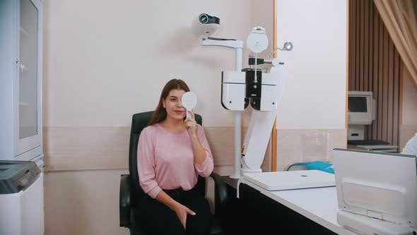 Thumbnail for Young Woman Checking Her Visual Acuity