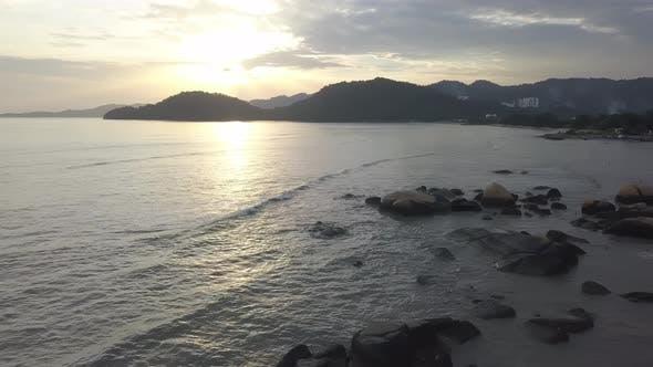 Sunset at rock stone near coastal