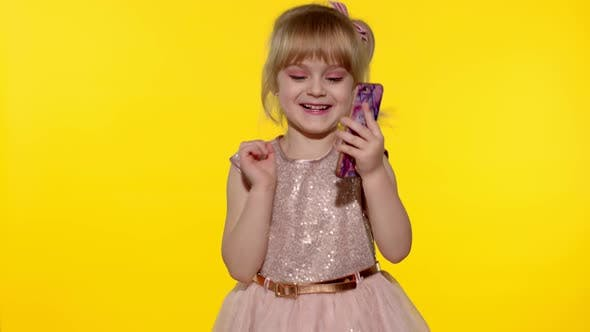 Thumbnail for Child Girl Dress Using Mobile Cell Phone Found Out Great Big Win News